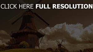 windmühle hügel wolken retro