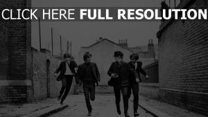 beatles laufen straße schwarz-weiß-foto