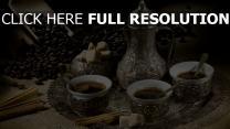 kaffee tassen topf zucker zimt bohnen