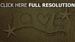 romantik text buchstaben muscheln sand