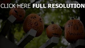 kürbis halloween balken gesichter holz