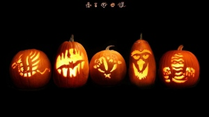 schwarzer hintergrund kürbis gesichter halloween zeichen lichter