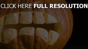 halloween schwarzer hintergrund kürbis zähne gesicht