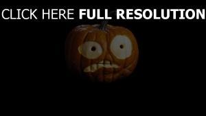 kürbis halloween gesicht schwarzer hintergrund staunen
