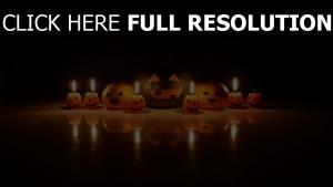 orange jack-o-latern kerze reflexion kürbis halloween