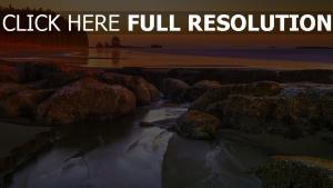 felsen meer strand nassen sand sonnenuntergang