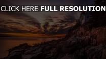 felsen steine leuchtturm himmel sonnenuntergang wolken bucht