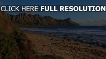felsen bergrücken bucht strand steine gras
