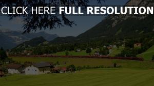 österreich zug berge gras häuser bäume