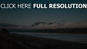 wolken berge meer