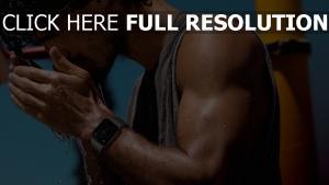 armbanduhr mann foto-shooting wasser sportler