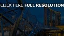 helix-brücke fluss beleuchtung gebäude abend singapur